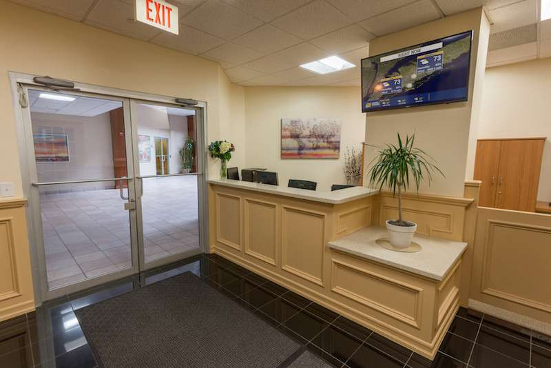 Melville Live Receptionist and Business Address Lobby